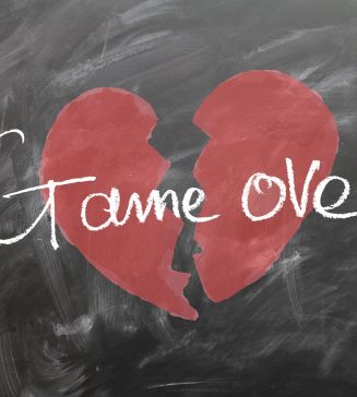 "Picture of a heart split in two with the words ""game over""."