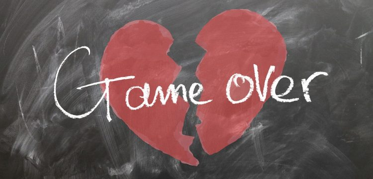 """Picture of a heart split in two with the words """"game over""""."""