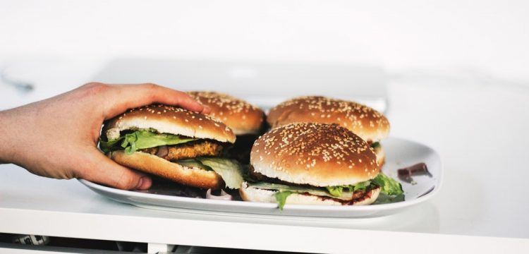 Hamburgers on plates.