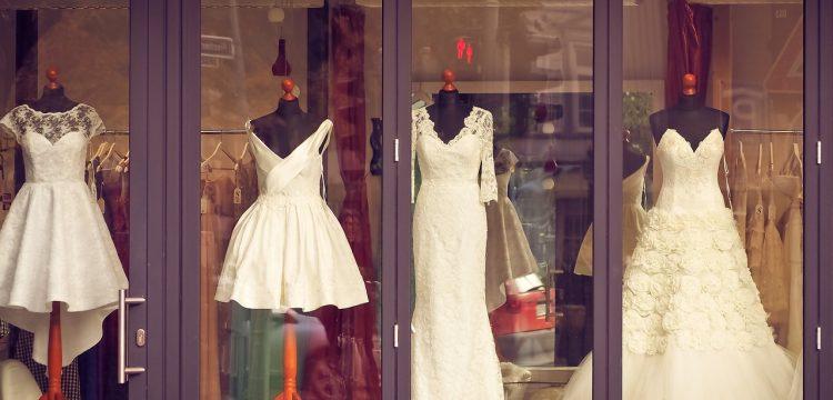 Wedding dresses on mannequins.