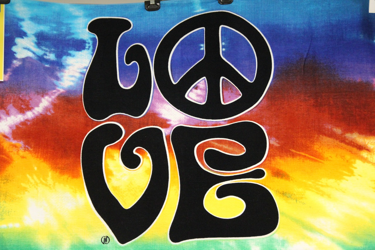 "The word ""love"" in a Woodstock-themed graphic."