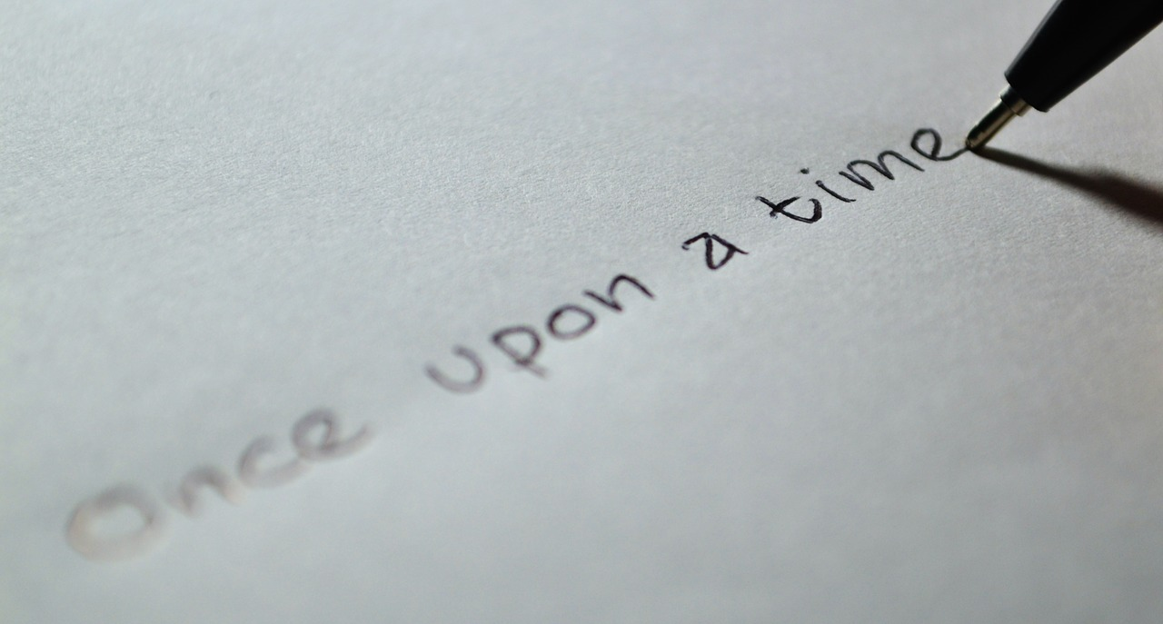 """A page with """"Once upon a time"""" written on it."""