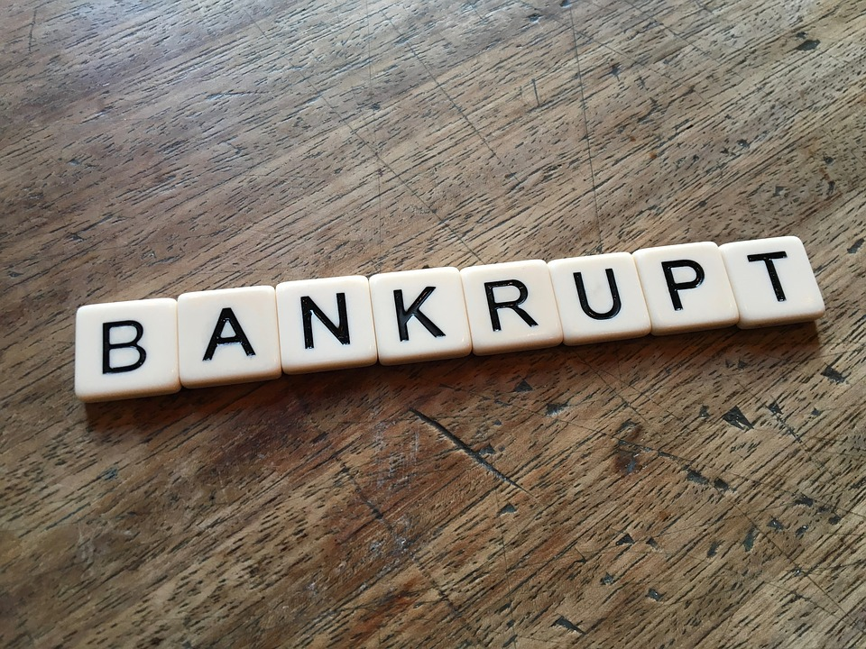 "Letters spelling out ""bankruptcy""."