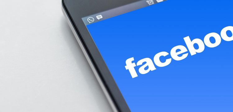 A phone screen with Facebook on it.