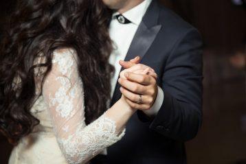 Married couple slow dancing.