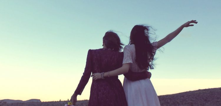 Two women with their arms around each other.
