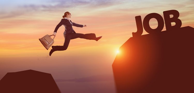 """Woman executive hopping to a cliff where the wording says """"Job""""."""