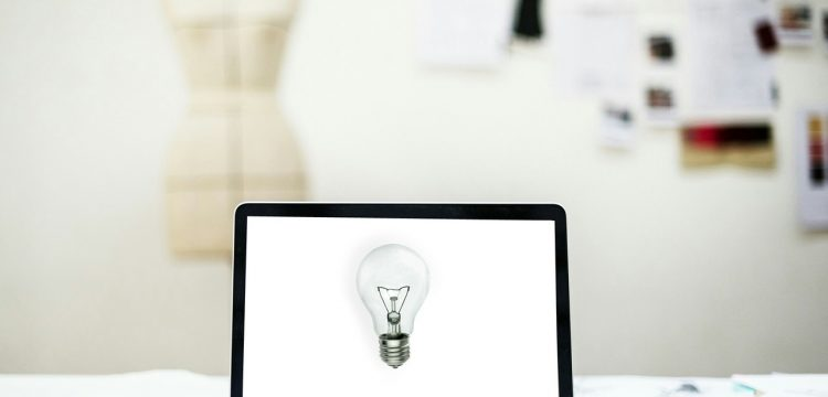 A laptop with a picture of a light bulb on it.