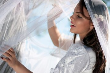 Bride holding a wedding veil.