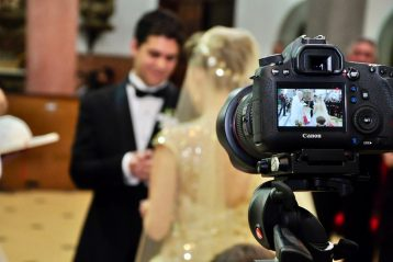 Bridal couple being filmed.