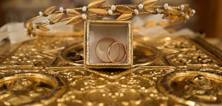 Two gold wedding bands in a fancy box.