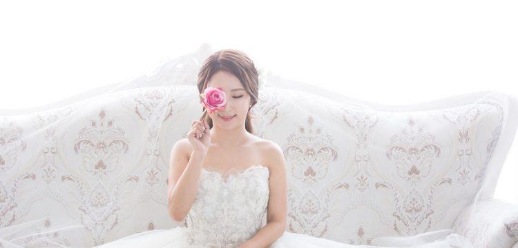 Woman wearing wedding gown.