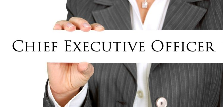 """Person holding a sign that reads, """"Chief Executive Officer""""."""