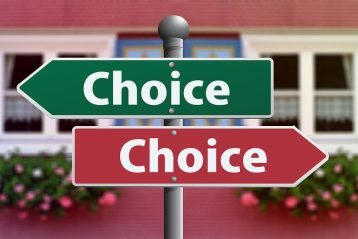 "Two signs pointing in different directions that both read, ""choice""."