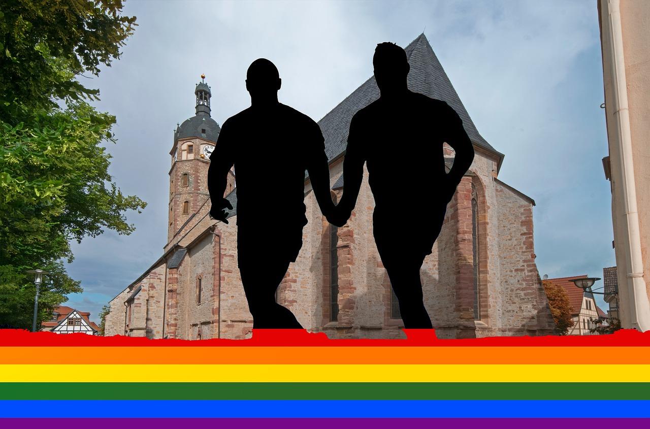 A gay couple with a rainbow flag.