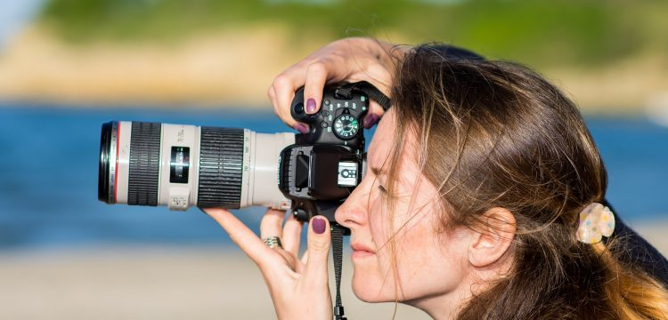 A woman photographer taking a picture.