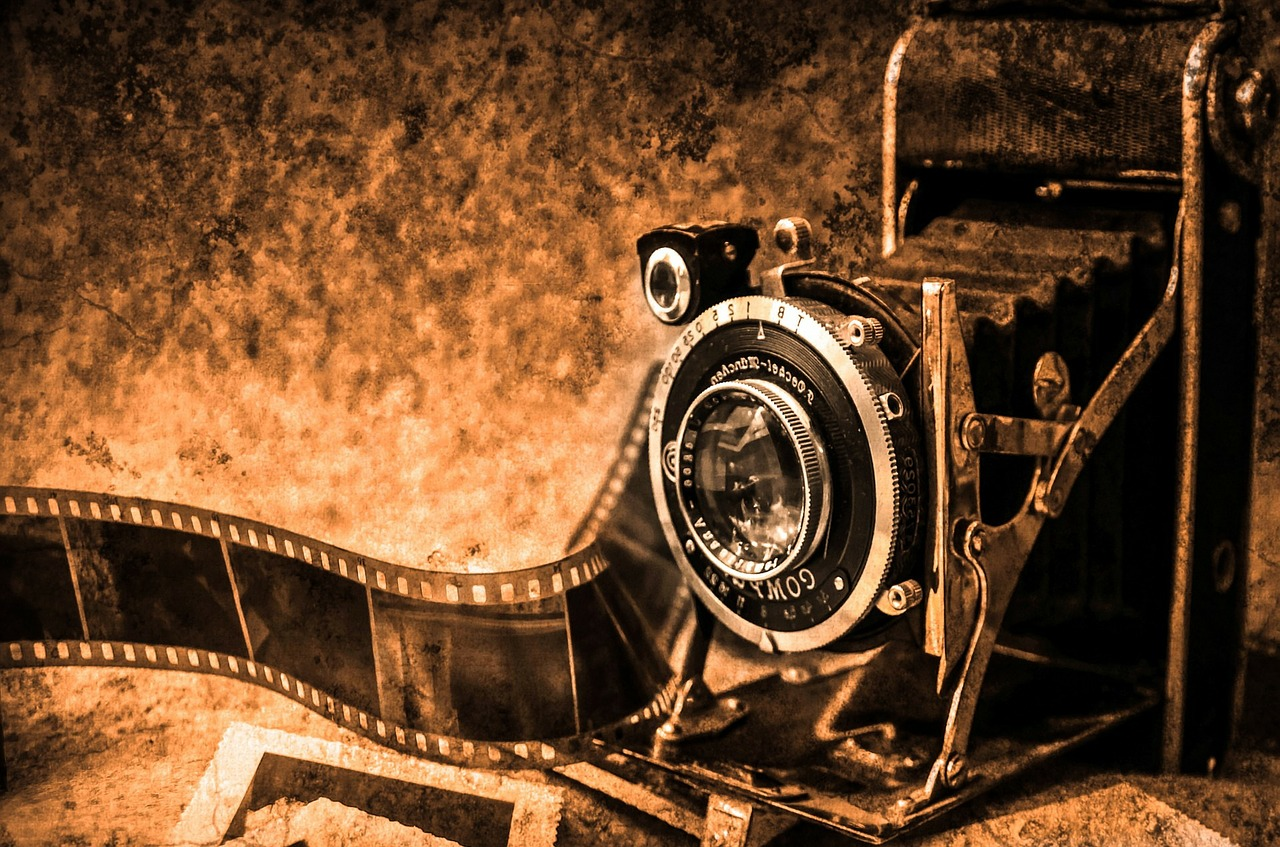 Picture of a camera with film coming out of it.