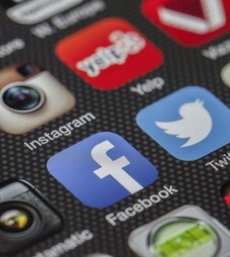 A close up of a phone showing different social media platforms.
