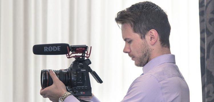 Man holding a video camera.
