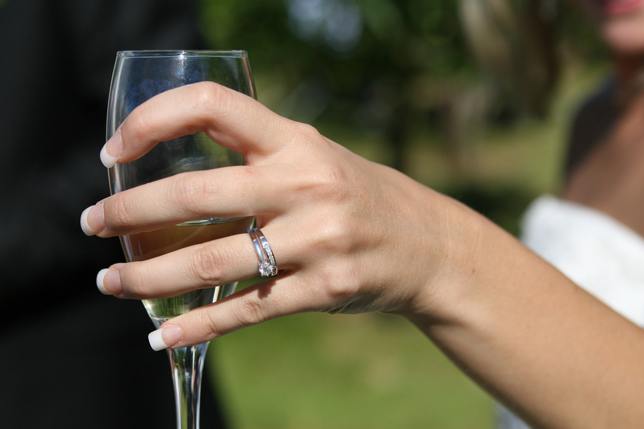Bride holding a champagne glass.