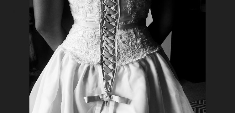 A bride with her back turned to the camera.