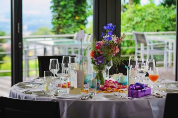 A nicely decorated dining table at a venue.