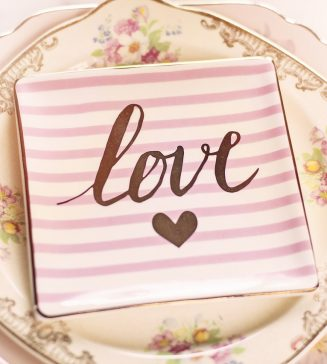 """A dessert plate with the word """"Love"""" on it."""