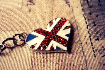 A keychain in the shape of a heart, featuring the British flag.