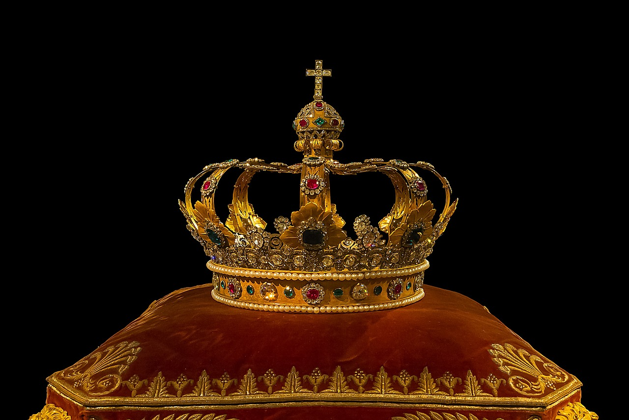 A crown sitting on a pillow.