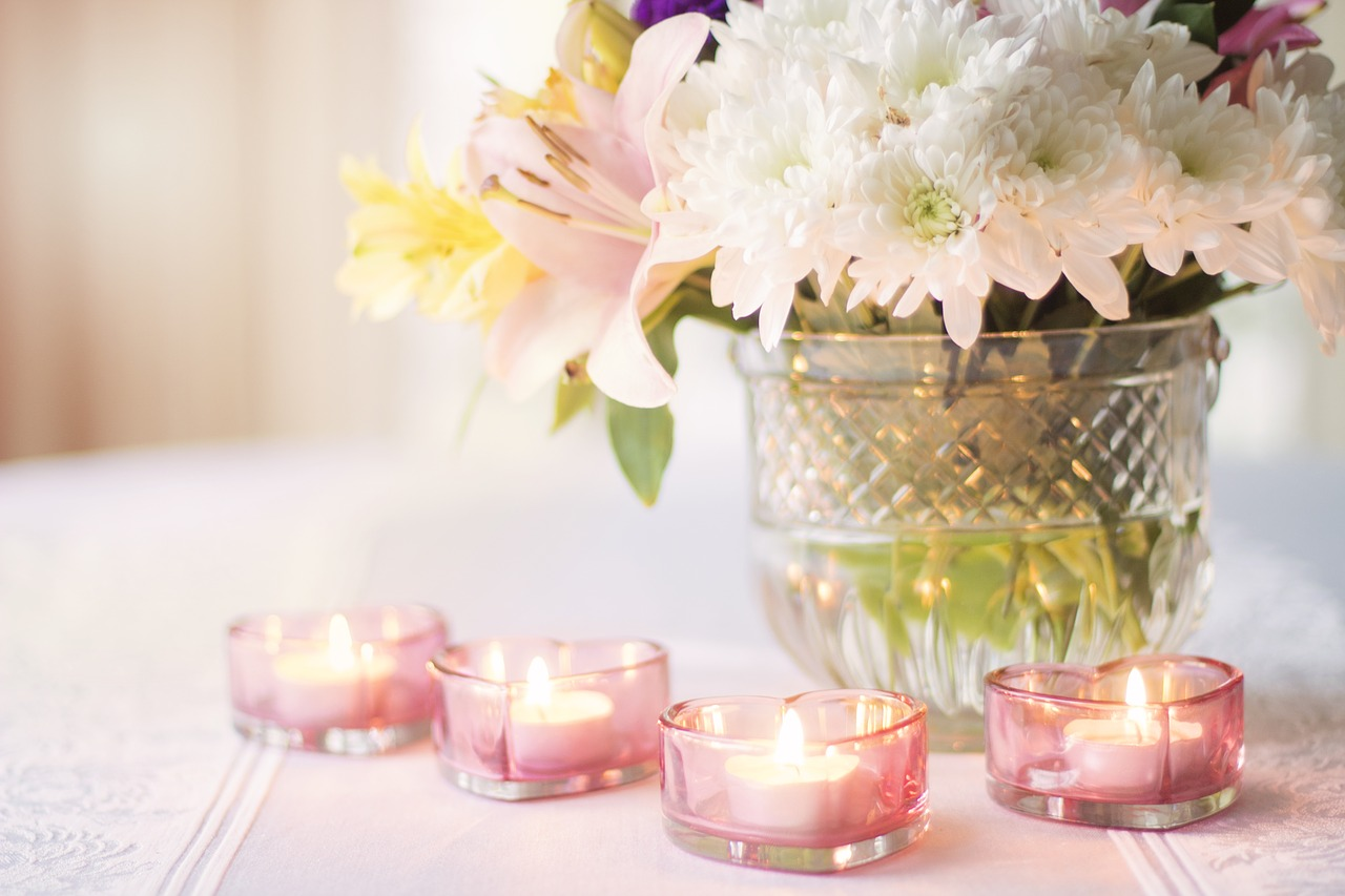 Floral centerpiece with candles surrounding it.