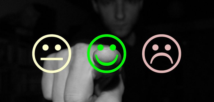 """Three """"smiley"""" faces that represent satisfaction or dissatisfaction."""