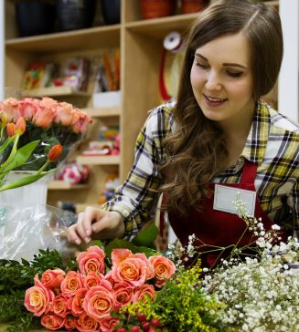 Woman working in a flower shop.