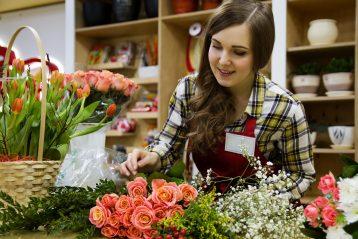 Woman working in a flower shop.