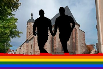 A silhouette of two gay men holding hands with a rainbow flag under them and a church in front of them.