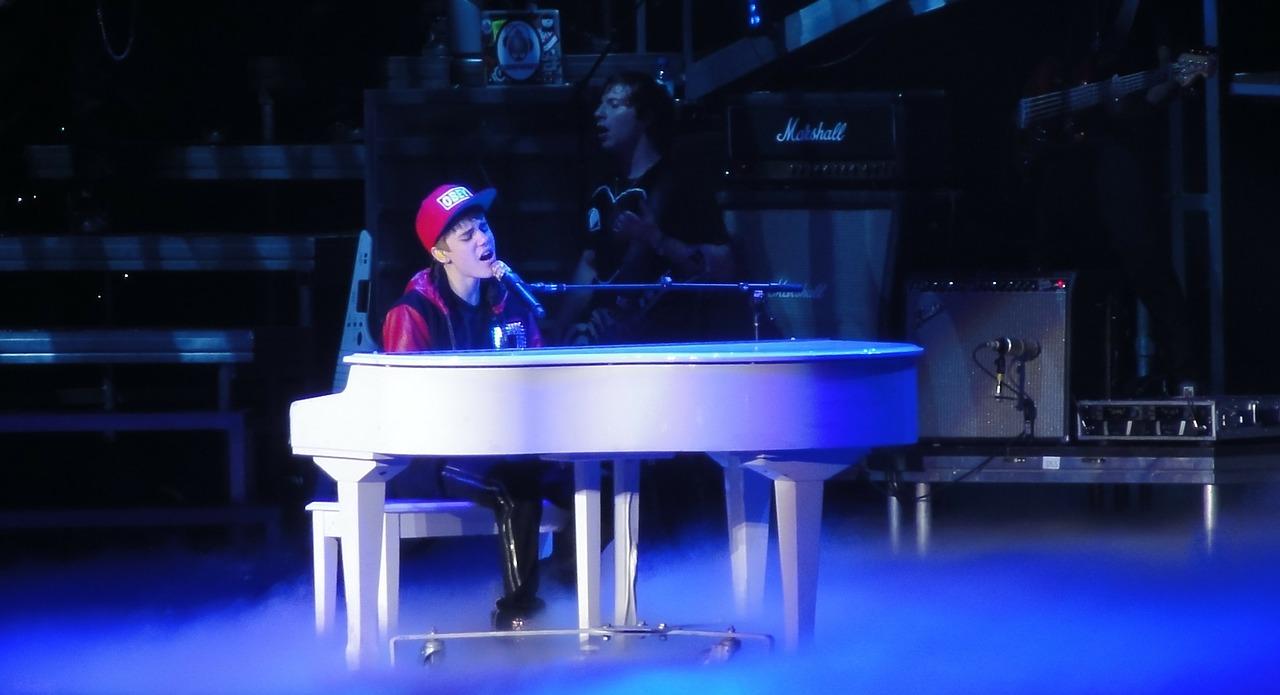 Justin Bieber, sitting at a piano.