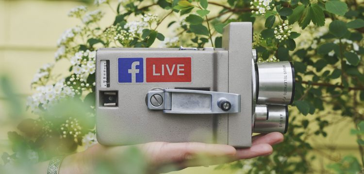 Camcorder with a Facebook Live sticker on it.