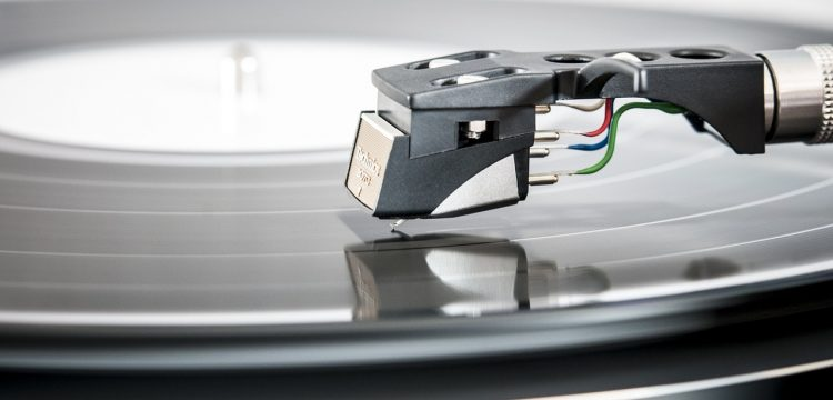 A needle on a record player.