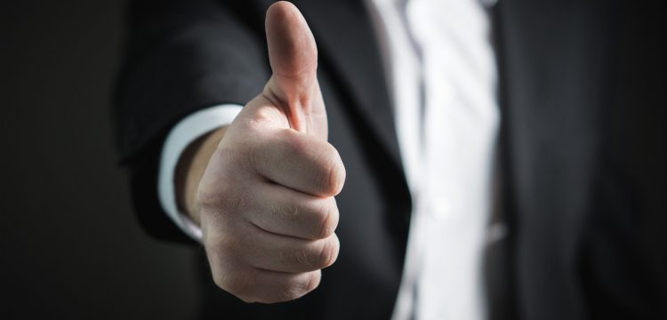 A man with his thumb up.