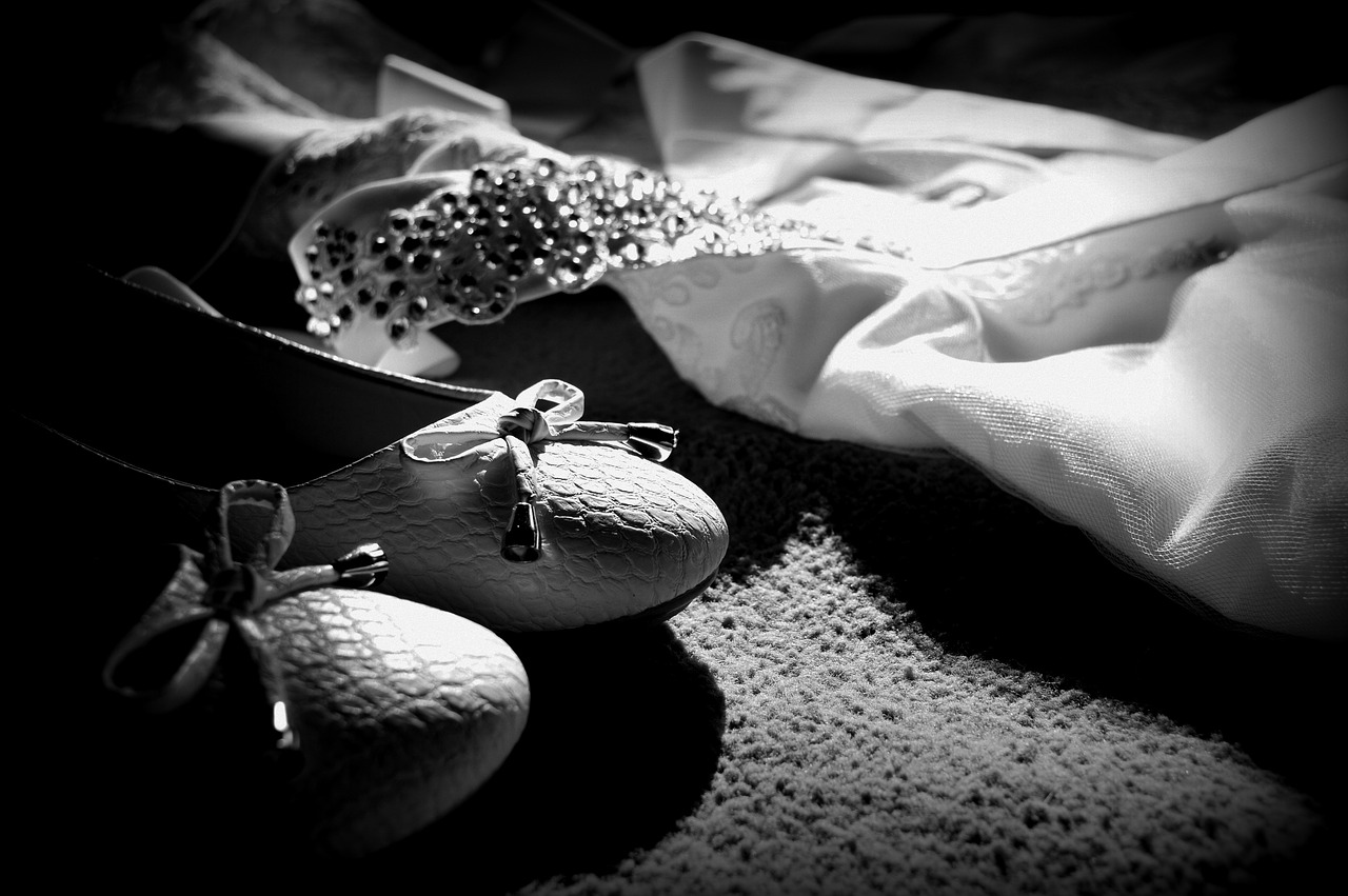 Black and white picture of wedding shoes, tiara, etc.