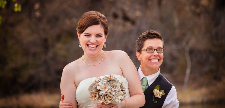 A lesbian couple in wedding attire.