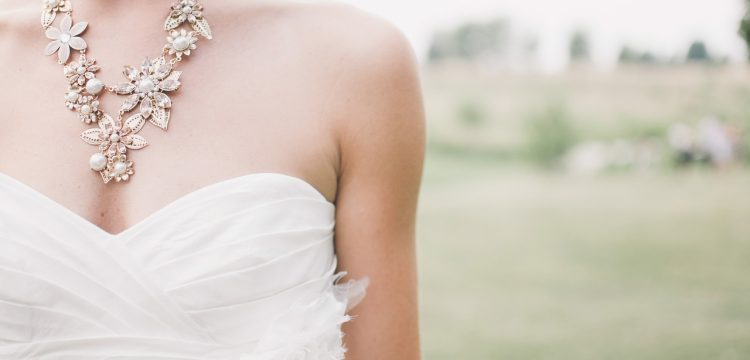 A casual country bride standing in a field.