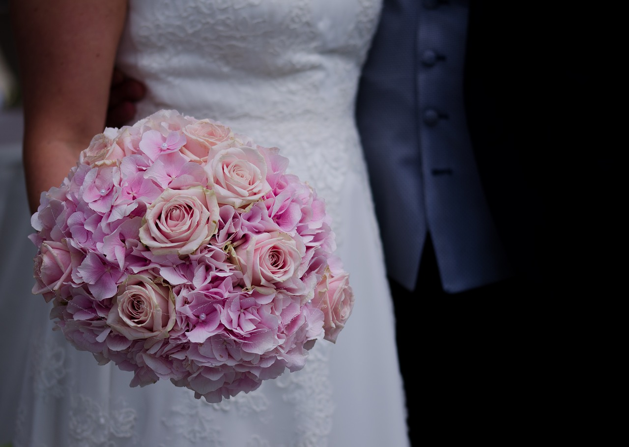 Bride holding a bouquet of roses.