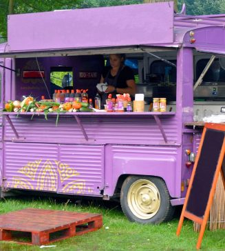 A purple food truck, serving drinks and food.
