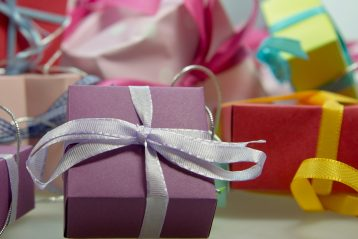 A bunch of neatly wrapped gifts with bows.