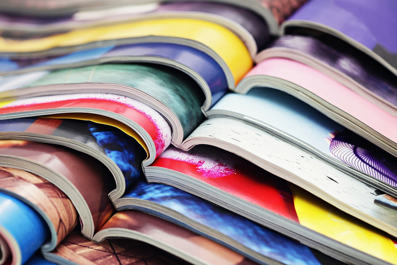A pile of magazines on top of each other.