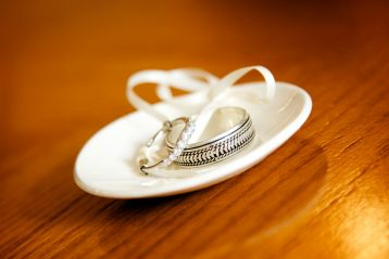 Woman's and man's wedding bands on a dish.