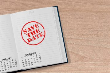"""A book opened to a page that reads, """"Save the Date""""."""