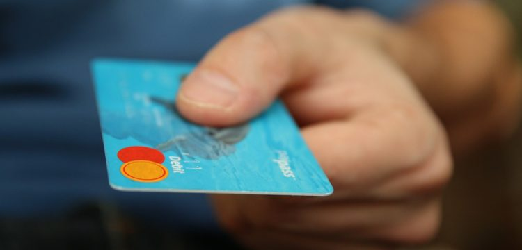A man holding a credit card.