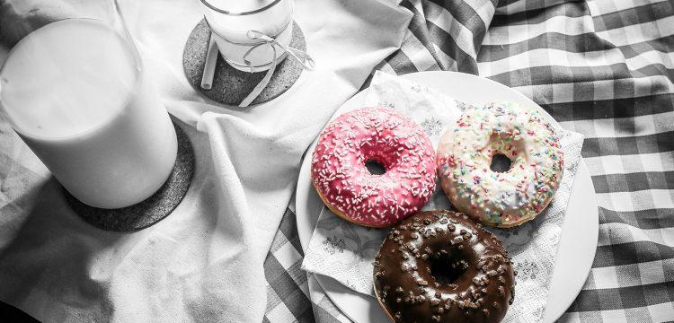 Three donuts on a dessert plate.