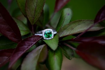 Engagement ring with a green stone.